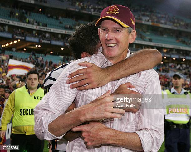 Wayne Bennett coach of the Broncos receives a hug from one of his players after the Broncos won the NRL Grand Final between the Brisbane Broncos and...