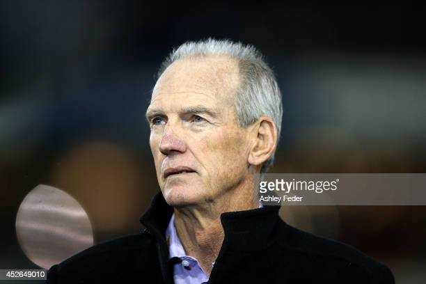 Wayne Bennett coach of the Knights looks on before the game during the round 20 NRL match between the Newcastle Knights and the Sydney Roosters at...