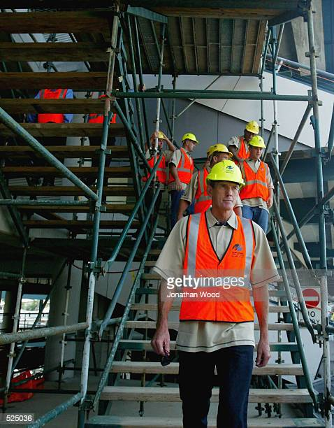 Wayne Bennett, Coach of the NRL Queensland State of Origin Team, leads his players through the renovations currently taking place at Lang Park in...
