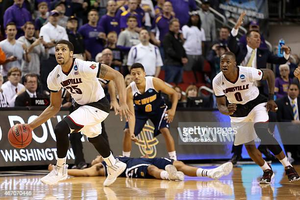 Wayne Blackshear and Terry Rozier of the Louisville Cardinals watch as the clock expires as Alex Young and Jaron Martin of the UC Irvine Anteaters...