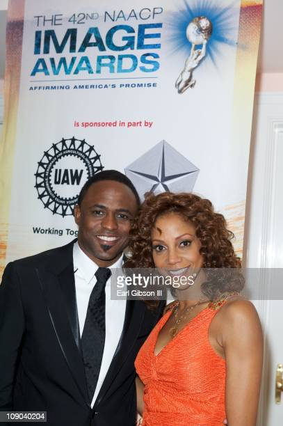 Wayne Brady and Holly Robinson Peete attend the 42nd NAACP Image Awards Nominees' Luncheon on February 12 2011 in Beverly Hills California