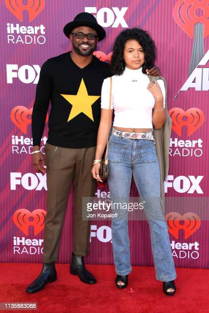 Wayne Brady and Maile Masako Brady attend the 2019 iHeartRadio Music Awards which broadcasted live on FOX at Microsoft Theater on March 14 2019 in...