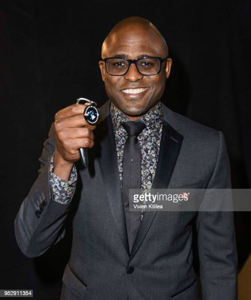 Wayne Brady poses with TAP medallion at 45th Daytime Emmy Awards Backstage with the Visual Snow Initiative on April 29 2018 in Los Angeles California