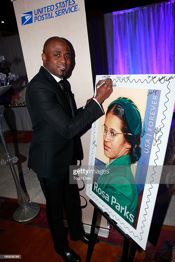 Wayne Brady previews the Rosa Parks Forever Stamp in the U.S. Postal Service Civil Rights Stamp Gallery backstage at the NAACP Image Awards on February 1, 2013 at The Shrine Auditorium.