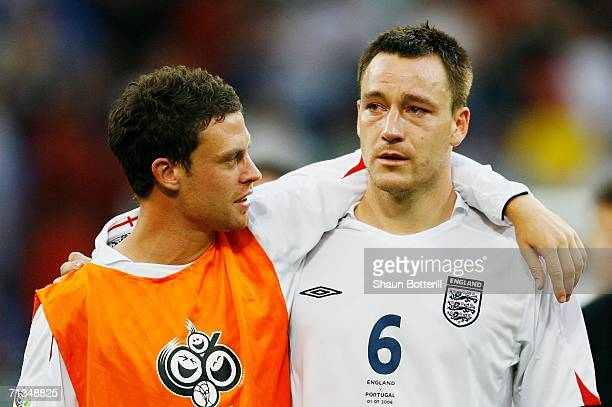 Wayne Bridge consoles England team mate John Terry following defeat during the FIFA World Cup Germany 2006 Quarterfinal match between England and...