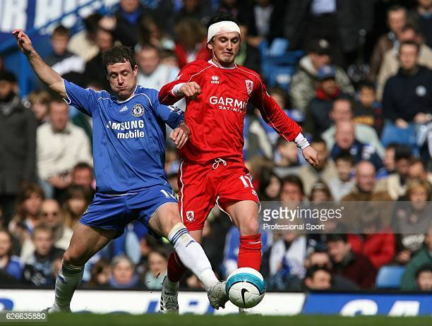 Wayne Bridge of Chelsea fights for the ball with Sanli Tuncay of Middlesbrough during the Barclays Premier League match between Chelsea and...