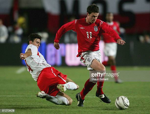 Wayne Bridge of England gets away from Michal Zewlakow of Poland during the 2006 World Cup Quailfier Group 6 match between Poland and England at the...