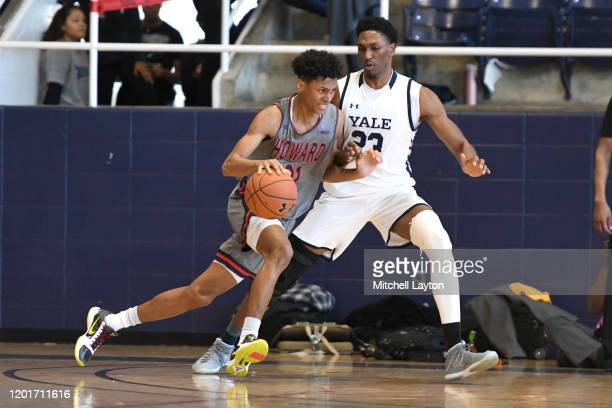 Wayne Bristol Jr. #31 of the Howard Bison dribbles by Jordan Bruner of the Yale Bulldogs during a college basketball game at Burr Gymnasium on...