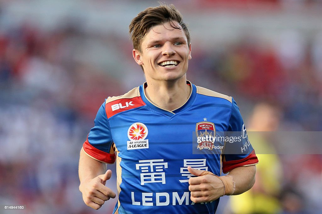 Wayne Brown of the Jets celebrates a goal during the round two A-League match between the Newcastle Jets and the Brisbane Roar at Hunter Stadium on October 16, 2016 in Newcastle, Australia.
