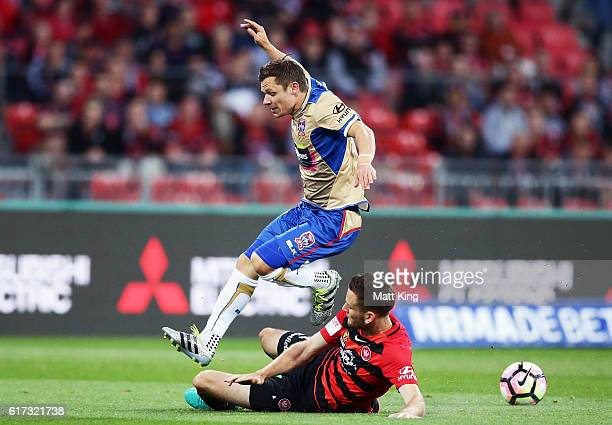 Wayne Brown of the Jets is challenged by Robbie Cornthwaite of the Wanderers during the round three ALeague match between the Western Sydney...