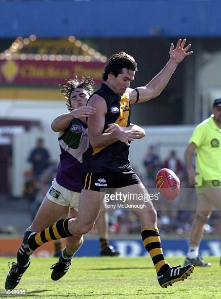 Wayne Campbell for Richmond is tackled by Paul Hasleby for Fremantle in the match between the Fremantle Dockers and the Richmond Tigers during round...