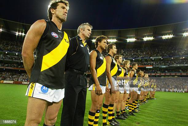 Wayne Campbell for the Tigers and coach Danny Frawley lineup during the national anthem before the round one AFL match between the Collingwood...