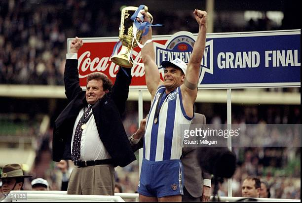 Wayne Carey and Dennis Pagan celebrate after North Melbourne won the Grand Final against the Sydney Swans in Melbourne Australia