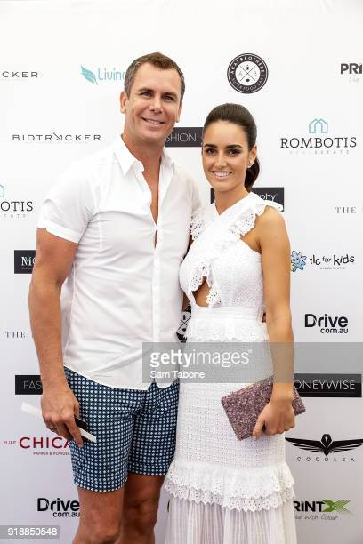 Wayne Carey and Jessica Paulke arrive at the Fashion Aid Twilight Beach Polo on February 16 2018 in Melbourne Australia