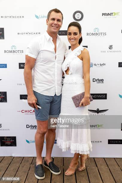 Wayne Carey and Jessica Paulke arrive at the Fashion Aid Twilight Beach Polo on February 16 2018 in Melbourne Australia
