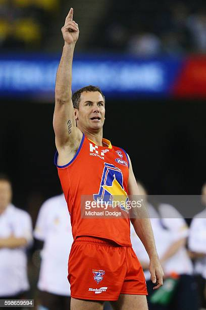Wayne Carey of the All Stars celebrates a goal prematurely when he kicks the ball for goal but ends up missing in the shootout during the EJ Whitten...