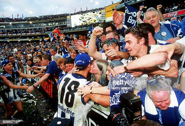 Wayne Carey of the Kangaroos celebrates with the crowd after winning the AFL Grand Final between the Kangaroos and the Carlton Blues at the Melbourne...