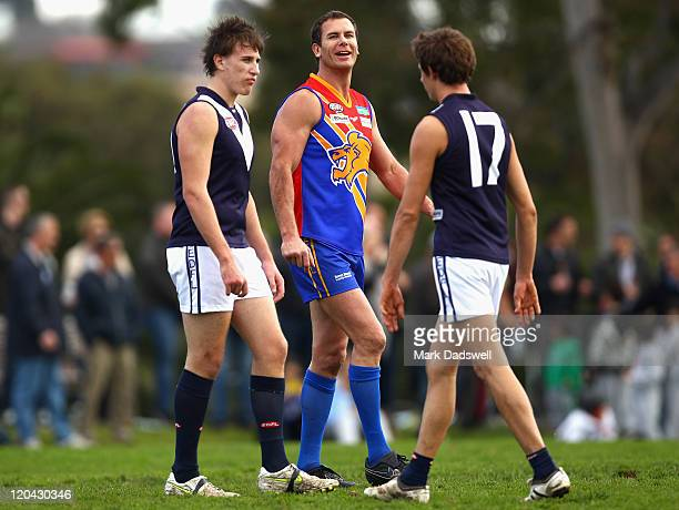 Wayne Carey of the Maribyrnong Lions exchanges words with Kirk Lang and Rhys Magin of the Heights during the Essendon Distrct Football League AFL...