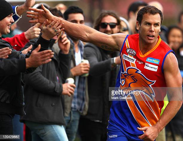 Wayne Carey playing for the Maribyrnong Lions high fives the crowd after snaping a goal during the Essendon Distrct Football League AFL match against...
