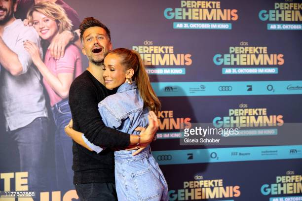 Wayne Carpendale and Annemarie Carpendale during the premiere of Das perfekte Geheimnis at Mathaeser Filmpalast on October 21 2019 in Munich Germany