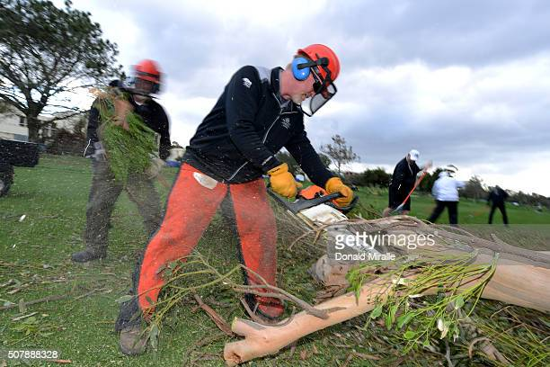 Wayne Carpenter superintendent of the North Course uses a chainsaw to clear fallen trees from the 15th fairway before play resumes during the final...