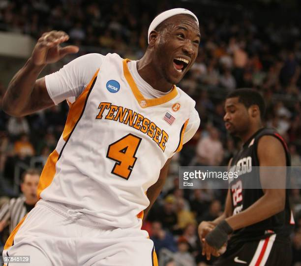 Wayne Chism of the Tennessee Volunteers celebrates his dunk as Chase Tapley of the San Diego State Aztecs look on during the first round of the 2010...