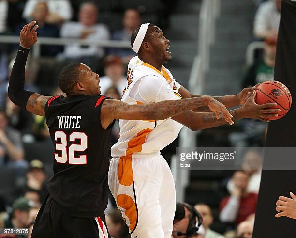 Wayne Chism of the Tennessee Volunteers heads for the net as Billy White of the San Diego State Aztecs defends during the first round of the 2010...