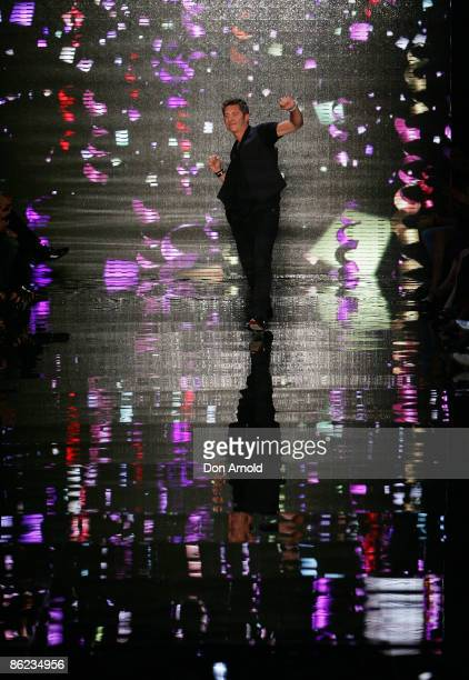 Wayne Cooper waves to the crowd on the catwalk at the Overseas Passenger Terminal, Circular Quay on day one of Rosemount Australian Fashion Week...