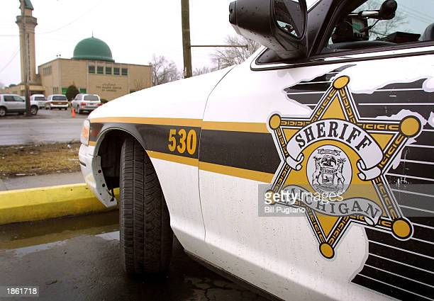 Wayne County Sheriff's vehicle guards the Islamic Center of America during a prayer service March 21 2003 in Dearborn Michigan Security has been...