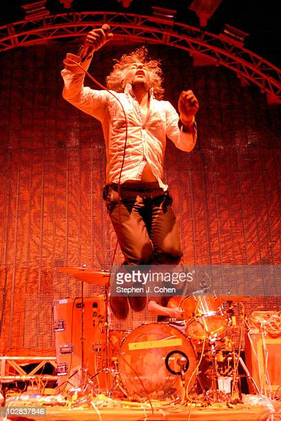Wayne Coyne and Kliph Scurlock of The Flaming Lips performs during the 9th annual Forecastle Festival at Waterfront Park on July 11, 2010 in...