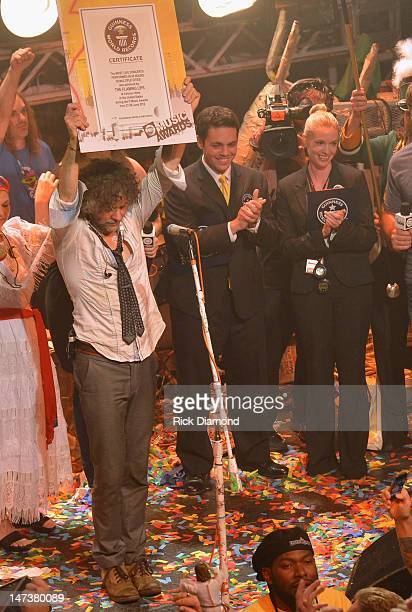 Wayne Coyne and The Flaming Lips accepts certificate from Amanda Mochan and Mike Janela of Guinness World Records on stage during the conclusion of...