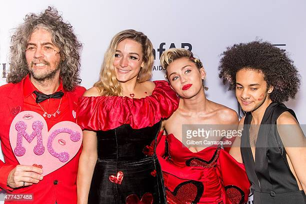 Wayne Coyne Katy Weaver Miley Cyrus and Tyler Ford attend the 2015 amfAR Inspiration Gala New York at Spring Studios on June 16 2015 in New York City
