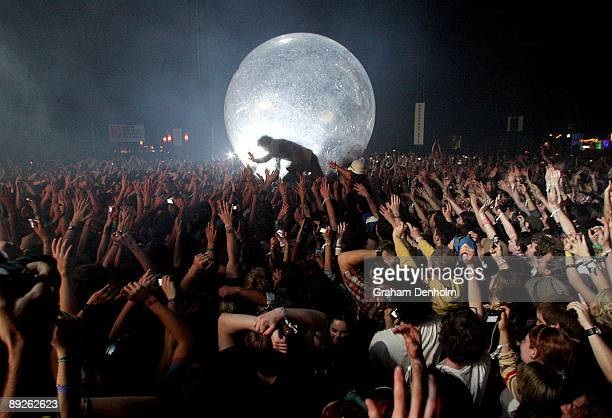 Wayne Coyne of the Flaming Lips climbs into the crowd in a large inflatable ball during the Splendour in the Grass festival at Belongil Fields on...