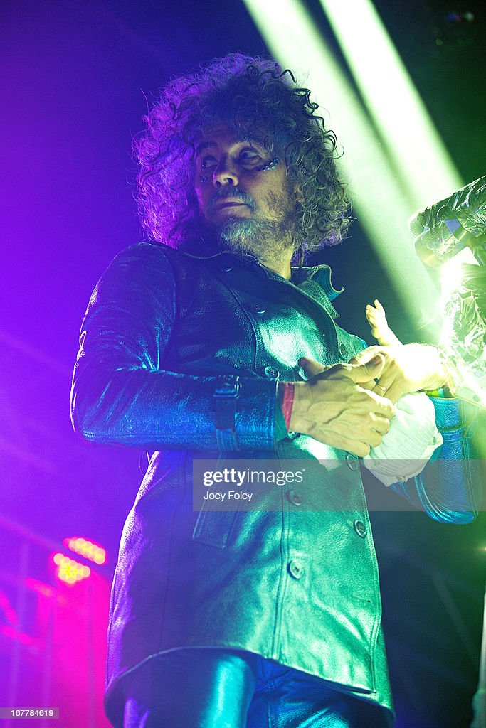 Wayne Coyne of The Flaming Lips holds a baby doll as he performs onstage at Egyptian Room at Old National Centre on April 29, 2013 in Indianapolis, Indiana.