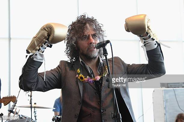Wayne Coyne of The Flaming Lips performs at the Muhammad Ali Center on July 14 2013 in Louisville Kentucky