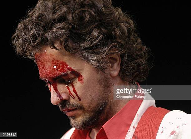 Wayne Coyne of The Flaming Lips performs covered in stage blood at The T In The Park Festival on July 12 2003 at Balado near Kinross in Scotland