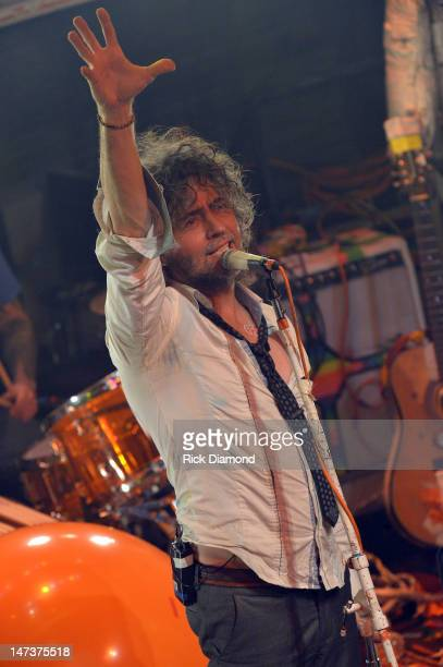 Wayne Coyne of The Flaming Lips performs in an attempt to set the Guinness Book of World Records for most shows in a day during the MTV, VH1, CMT &...