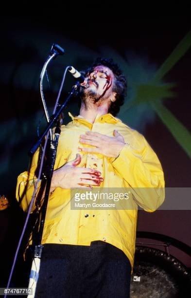 Wayne Coyne of the Flaming Lips performs on stage at Glastonbury Festival wearing a kagool and covered in fake blood 24th June 2000