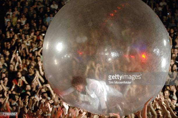 Wayne Coyne 'walks' in a giant ball over the crowd as The Flaming Lips perform in support of the band's 'At War with the Mystics' release at the...