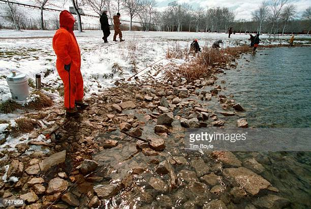 Wayne Daniel from Chicago left fishes for rainbow trout at Belleau Lake Park Ridge Il April 8 2000 Many fishermen participated in the opening day of...