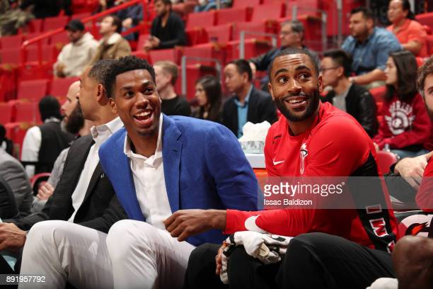 Wayne Ellington and Hassan Whiteside of the Miami Heat looks on during the game against the Portland Trail Blazers on December 13 2017 at American...