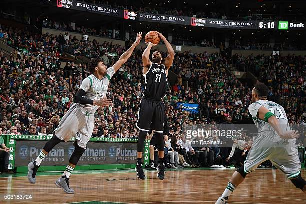 Wayne Ellington of the Brooklyn Nets shoots the ball against James Young of the Boston Celtics on January 2 2016 at the TD Garden in Boston...