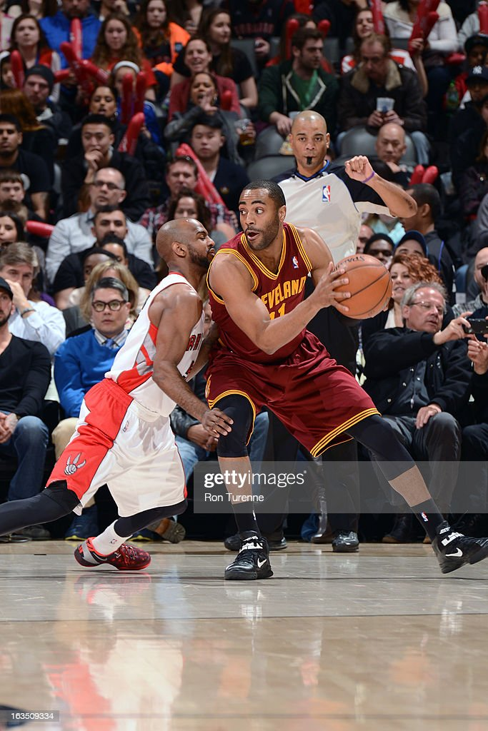 Wayne Ellington #21 of the Cleveland Cavaliers handles the ball against John Lucas #5 of the Toronto Raptors on March 10, 2013 at the Air Canada Centre in Toronto, Ontario, Canada.