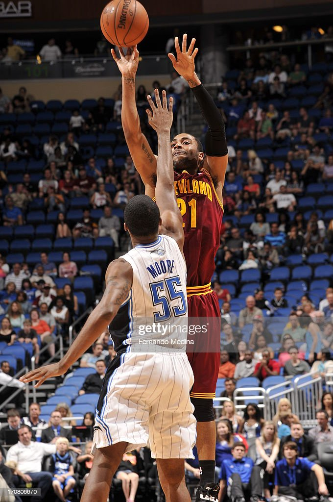 Wayne Ellington #21 of the Cleveland Cavaliers shoots against E'Twaun Moore #55 of the Orlando Magic during the game on February 23, 2013 at Amway Center in Orlando, Florida.