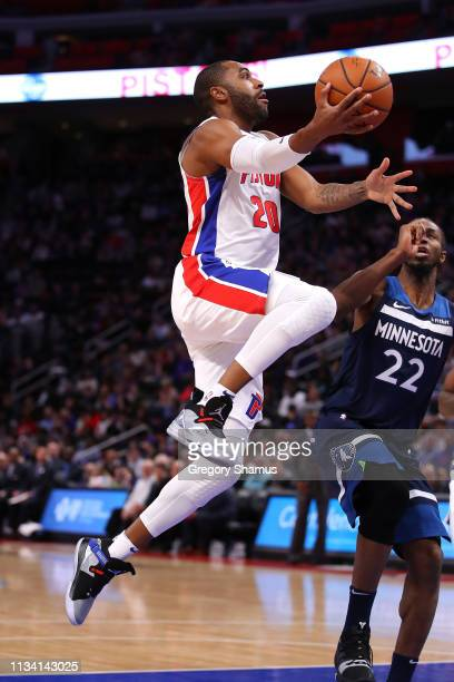 Wayne Ellington of the Detroit Pistons tries to get to the basket past Andrew Wiggins of the Minnesota Timberwolves during the second half at Little...