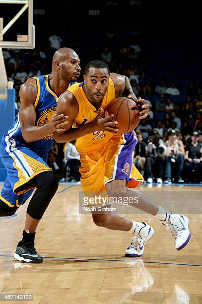 Wayne Ellington of the Los Angeles Lakers handles the ball against Leandro Barbosa of the Golden State Warriors on October 12 2014 at Citizens...