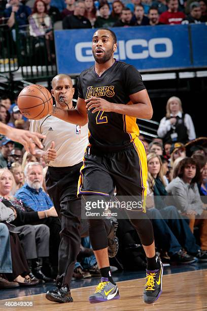 Wayne Ellington of the Los Angeles Lakers handles the ball against the Dallas Mavericks on December 26 2014 at the American Airlines Center in Dallas...