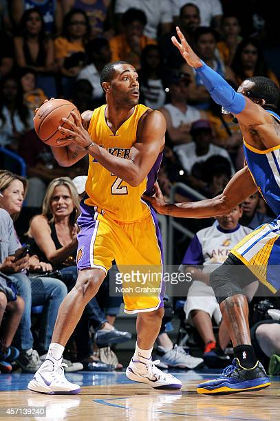 Wayne Ellington of the Los Angeles Lakers handles the ball during the game against the Golden State Warriors on October 12 2014 at Citizens Business...