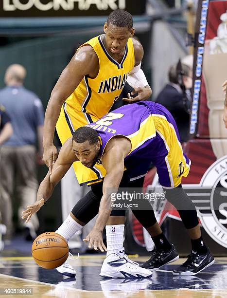 Wayne Ellington of the Los Angeles Lakers reachews for a loose ball during the game against the Indiana Pacers during the game at Bankers Life...