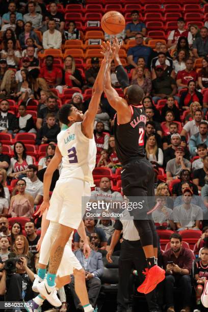 Wayne Ellington of the Miami Heat and Jeremy Lamb of the Charlotte Hornets battle for the ball during the game on December 1 2017 at American...